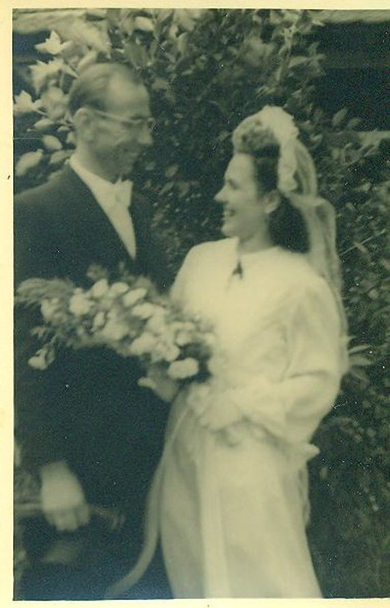1930s Wedding Photo Bride Groom White Slim Gown Dress Veil Bouquet Standing Outside Holding Hat Love
