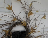 Beautiful grapevine wreath with gold essentials