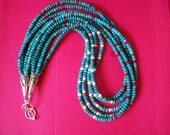 From Another Time and Place-Five Strands of Green and Blue Turquoise Highlighted with White FW Pearl and Red Coral