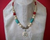 Bone Om Pendant Inlaid with Turquoise and Coral Strung with St. Silver, Pearl, Turquoise, and Red Coral