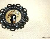 oval brooch with bird girl in the head handmade by Ladyblackness