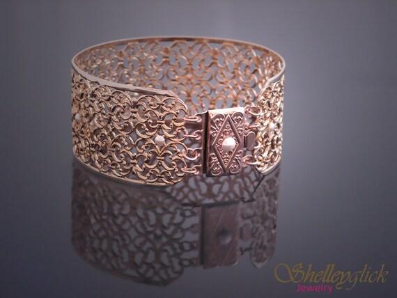 Wide filligree rose gold plated bracelet