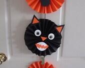 Halloween pumpkin and cat medallions