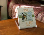 Just Reduced-Our New Year Bird and Swirl Desk Calendar-2012