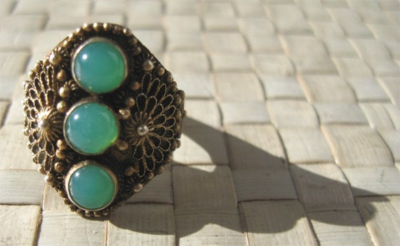 Exotic filigree and green stone cocktail ring--silver and gold wash