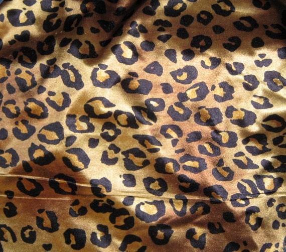 Lycra gold   leopard  print  shiny   slinky  60 wide last yard