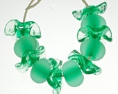 handmade lampwork glass beads pale emerald lampwork bead set of 11  seaglass and crystal from Paulbead