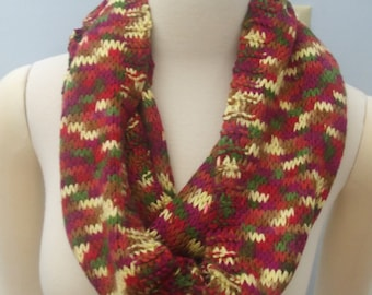 Multi Color Knitted Eight Foot Scarf. The colors are Red, Yellow, Green, Pumpkin, Rust, Brown