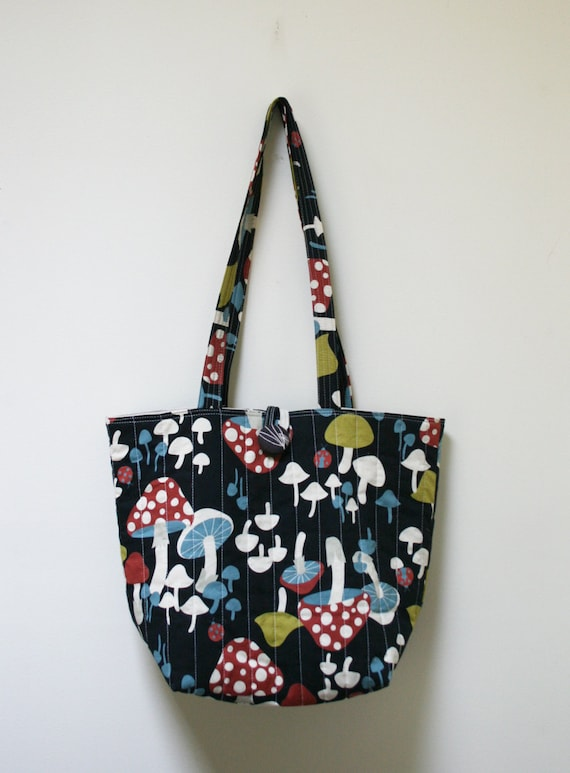 Quilted Tote Everyday Bag with colorful mushrooms over black background