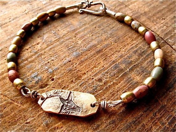 golden tundra deer bracelet : rustic nature jewelry . bronze, brass, red jasper beads, sterling silver . handcrafted