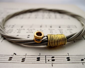 Recycled Bass Guitar String Bracelet silver colored with brass ball end attached Unisex Musician Gift