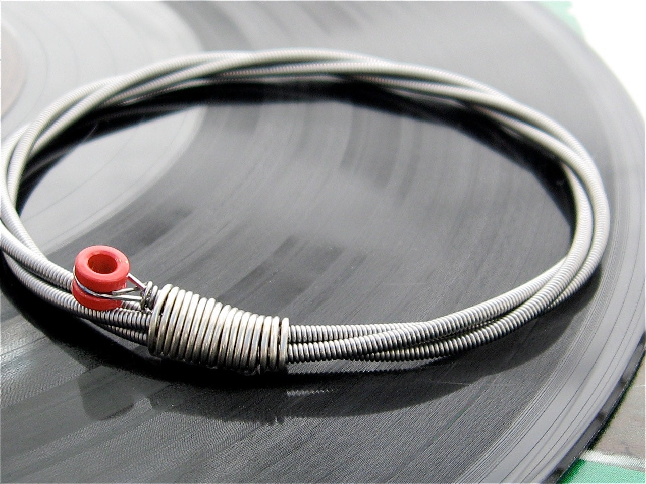 recycled bass guitar string bracelet with red brass ball end. Black Bedroom Furniture Sets. Home Design Ideas