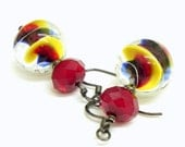 Hand Blown glass Earrings - Blue, red and yellow swirls