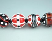 White, black and red, Handmade lampwork glass beads.