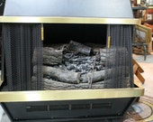Vintage Metal Fireplace chalet style with logs and lights and heat