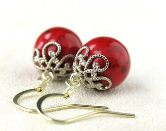 EE06011202) Red fossil ball dangling earrings