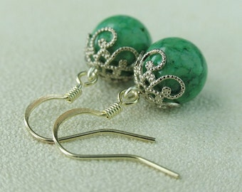 EE060110503) Green fossil ball dangling earrings