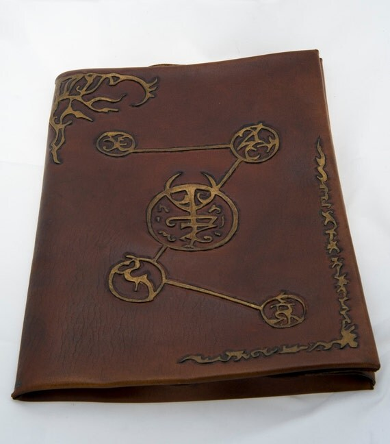 Embossed leather case with art work scrolls horror cthulhu or larp prop