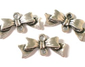 12 silver metal bow connector charms 20x10x3mm