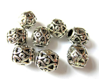Metal beads antique silver 10 embossed ethnic spacers 10mm 7mm A934 (SR6SB)