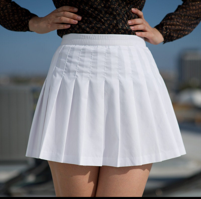 white pleated mini tennis skirt