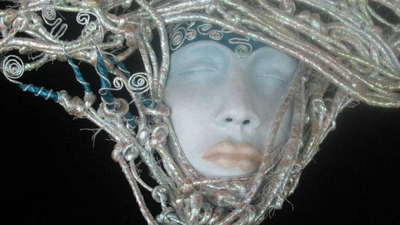 Sold, Mask irridescent wrapped coiled headpiece