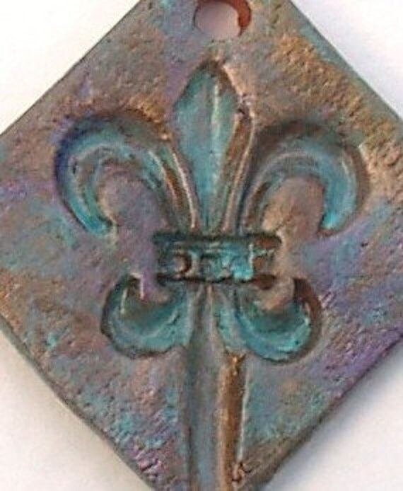 Fleur de lis Pottery Pendant in Bronze Metallic with Verdigris Patina by Clay Designs by glee