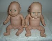 two soft plastic baby dolls