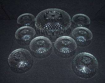 vintage clear crystal salad bowl with 8  match ing smaller    bowls