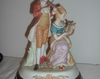 beautiful ceramic figurine music box plays the minute waltz