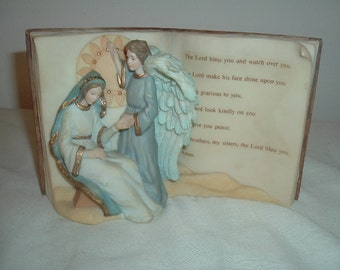 vintage musical ceramic bible and plaque of virgin mary holding jesus