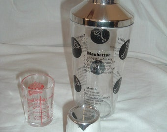 vintage plastic drink mixer and glass jigger