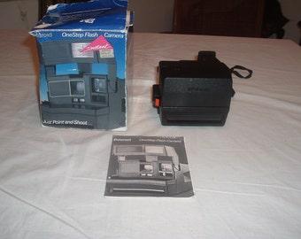 Polaroid one step flash camera