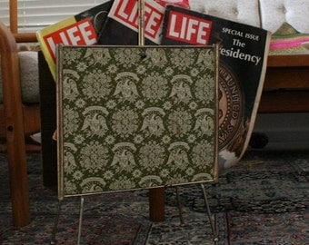 mid century brass and faux wood mad men magazine rack