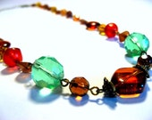 Lisa - brown, red, green, yellow, orange, pink, and dark gold long necklace