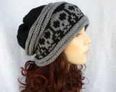 Hand knit Slouch hat with skulls in black and gray