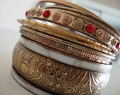 BaNgLE BuNdLe: Eleven gold tone vintage bangle bracelets