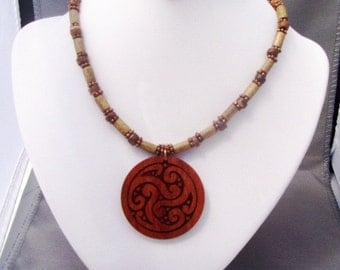 Carved wood pendant necklace