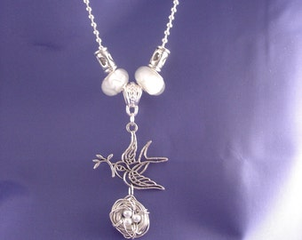 Lampwork Glass Beaded Wire wrapped Bird and nest necklace