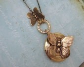 BUTTERFLY KISSES  vintage brass locket necklace with butterfly charms and vintage Swarovski rhinestone connector