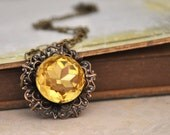 THE SUNFLOWER, antique brass necklace with vintage topaz glass jewel
