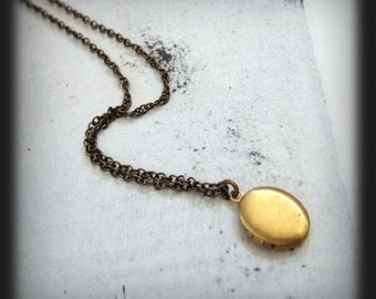CUTE AS A BUTTON, tiny vintage brass locket necklace