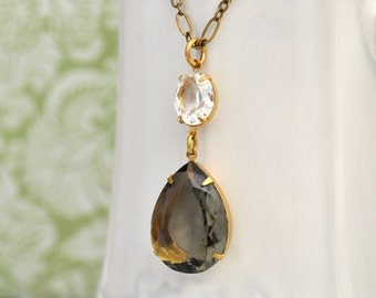 VINTAGE SPARKLE, antique brass necklace with large gray color pear shaped glass jewel
