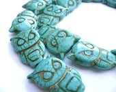 Turquoise coloured magnesite owl pendant beads - 5 pieces