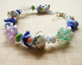 Snowman Bracelet,  Winter Memories are made of Snowflakes, Mittens, Skates, and Snowmen