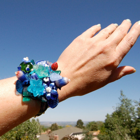 Navy blue bracelet, corsage beaded bracelet, vintage watchband with glass flower beads, blue bouquet of flowers