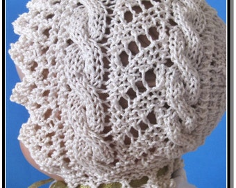 Knitted Lace Baby Bonnet PDF downloadable knitting pattern Cable Road