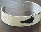 bird collage bracelet