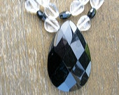 Clear glass and faceted black bead necklce with tear drop pendant