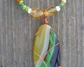 Gorgeous Green necklace with copper wire wrapped pendant